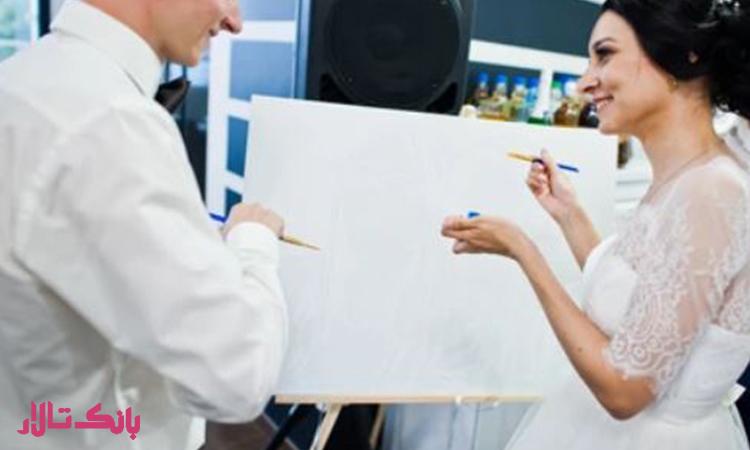 نقاشی روی بوم توسط عروس و داماد از ایده های جذاب تشریفات عروسی